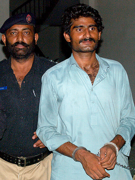 Wasim (R), the brother of slain social media celebrity Qandeel Baloch, is escorted by police following his arrest for Qandeel's death in Multan early on July 17, 2016. A Pakistani social media celebrity whose selfies polarised the deeply conservative Muslim country has been murdered by her brother in a suspected honour killing, officials said July 16, prompting shock and revulsion. / AFP / SS MIRZA (Photo credit should read SS MIRZA/AFP/Getty Images)
