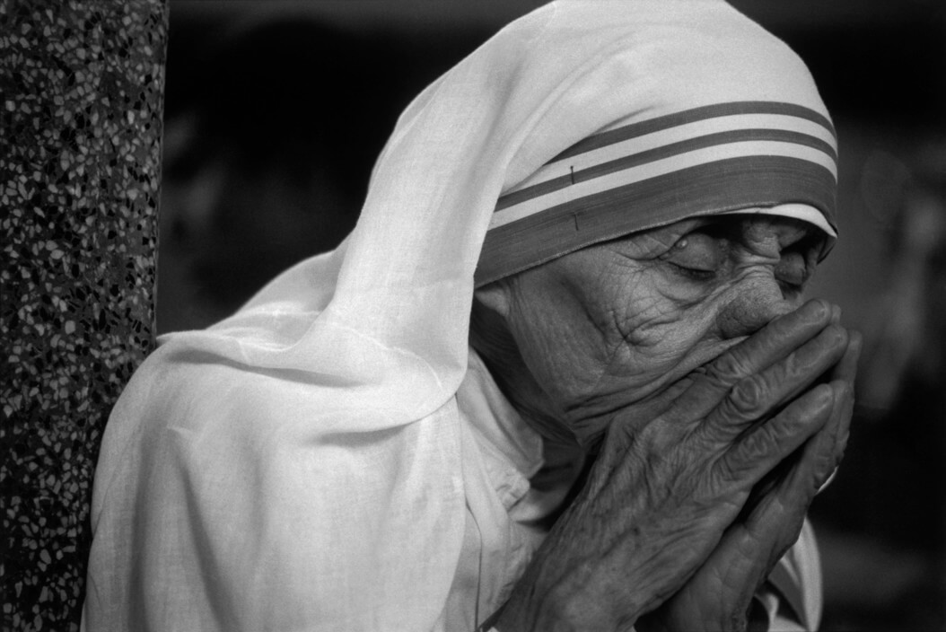 INDIA. Mother Teresa. 1989. Mother Teresa at her refuge of the Missionaries of Charity in Calcutta. During prayer. Mother Teresa is the leader of the Missionaries of Charity (Nirmal Hridaya/Pure Heart) Order which is located in Calcutta.They were founded by in 1957 when she ran a home for the dying and destitute Nirmal Hriday in the Kalighat suburb of Calcutta.In 1979 she was awarded the Nobel PEACE PRIZE, and has continued to travel the world in charitable efforts to expand her Missionary of Charity to other countries outside of India. She was born on the 27th August 1910 in Skopje (Yugoslavia) her maiden name is Agnes Gonxha Bajaxhiu.
